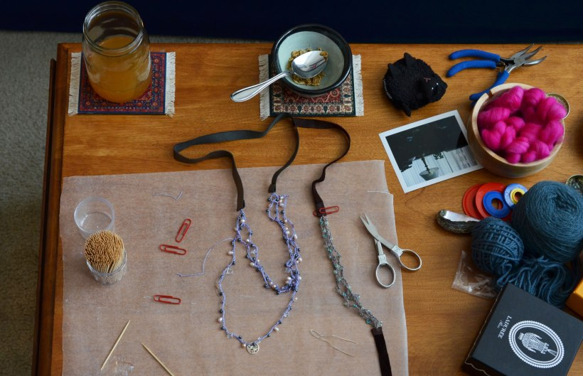 Necklace in progress (with cider and homemade granola in the background)